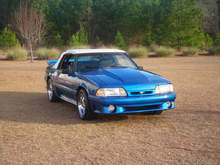 1991 Mustang GT convertible, chrome cobra rims, 2 inch cowl hood, saleen rear spoiler, flowmasters