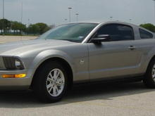 2009 V6 Mustang with spoiler and automatic. Vapor Gray colored!
