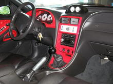 interior with red painted accents, pro 5.0 shifter. changing all gauges to black face brushed bezels.