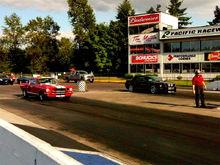 Me racing against my husbands 65 Mustang