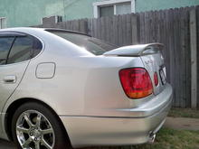 With trunk spoiler