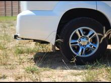 Side view w/ the crappy flaking OEM chrome wheels. Boooooooooooo