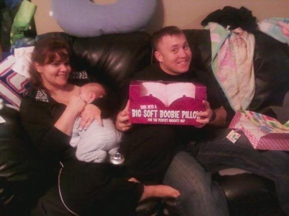 my beautiful wife, new nephew, and my new boobies.........