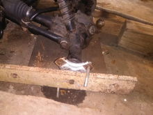 After first nut breaks brace like this to break other side with the cheater bar and pipe wrench.