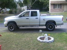"""level kit with 33"""" tires and black rims"""