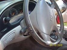 He had it 18 months.  The steering wheel was slightly worn when he got it...... DANG !