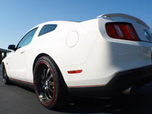 Quick photoshop mock for adding some subtle red pinstripes to play off the red wheel stripe