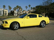 Yellow Mustang driver side
