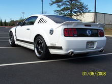 "Then I went with Roush spoiler, 1/4 window louvers, 4"" exhaust tips, blackout panels and tailight bezels. tint, mirror covers, sequential tails, black gas cap cover."
