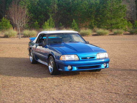 1991 Mustang GT convertible, chrome cobra rims, 2 inch cowl hood, saleen rear spoiler, flowmasters