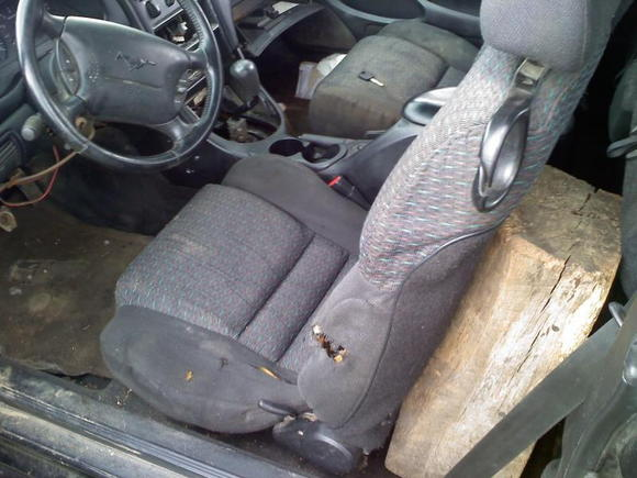 Day 1....it was trashed inside. The Block of wood was being used to hold the seat in place.