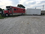 2000 Freightliner with 2 car piviot lift car hauler