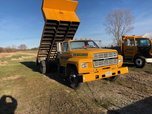 94 Ford F700 - 16' Flat bed Dump Truck  for sale $8,500