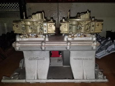 BIG BLOCK CHEVY TUNNEL RAM WITH CARBS.