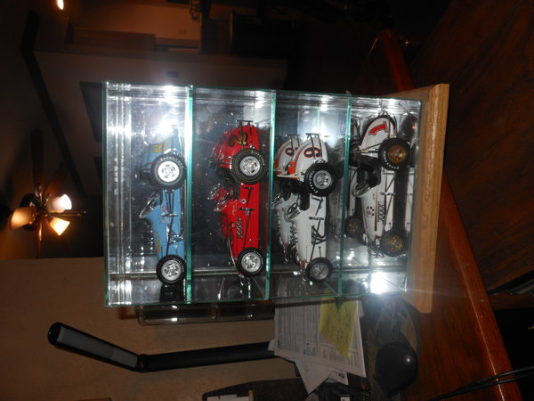 4 cars an display case  for Sale $250