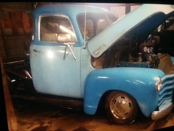 1949 5 window Chevy.