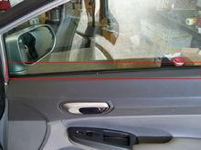 Front Passenger Door. Red rectangel around rubber against window.
