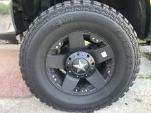 """These are 18"""" KMC XD Rockstars with gladiator 35"""" M/T on them.  I love the wheels and tires.  The wheel sells for about $200 and the tire is about $300 each.  All around looking at $2000 for all 4 or $2500 to get a matching spare too.  I've heard of people fitting 35"""" tires on a leveled truck, but it rubs like hell.  Mine are 12.5"""" wide and I like them, I'm also lifted though so I get no rub."""