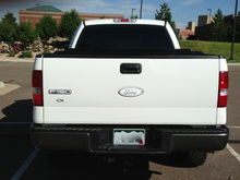Rear View of F-150 and Ford Emblem Overlay