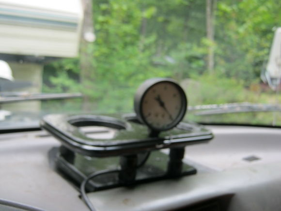 Sorry a bit fuzzy but this is my vacuum gauge and cup holder