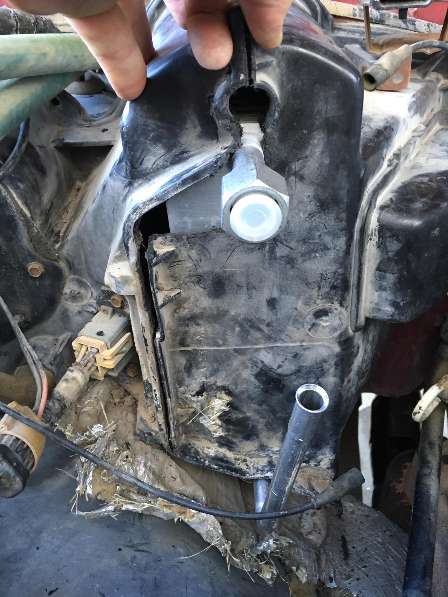 The 95 r134a evaporator was not a direct fit for the 92s airbox nothing a dremel and some black silicon caulk couldn t fix