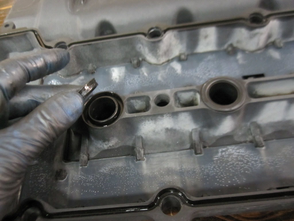 Removing the valve cover gasket removing the spark plug wells o rings