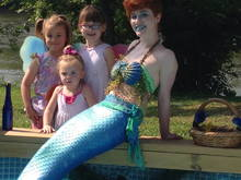 Matilda, Evelyn and Adelaide meeting a mermaid