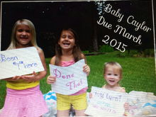 """The signs say """"been there"""", """"done that"""", """"my turn! Being promoted to big sister march 2015"""""""