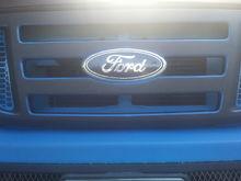 Black badges Blue 45's on black grill