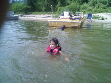 my  niece  swiming   behind the boat  out  at the islan