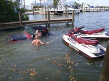 Skinhead #2 has the boats under control and tells the jeep driver he does not need to back in that deep.