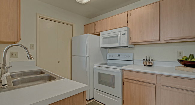 St. James Place Kitchen View with Fridge, Oven, and Microwave
