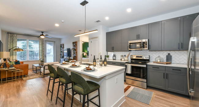 Kitchens are complete with an entertaining island and quartz countertops.