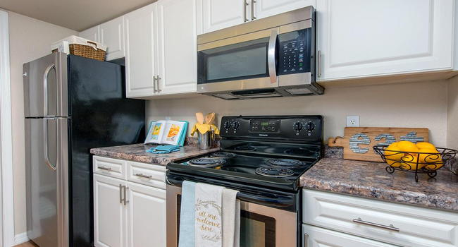 Kitchens feature stainless steel appliances.
